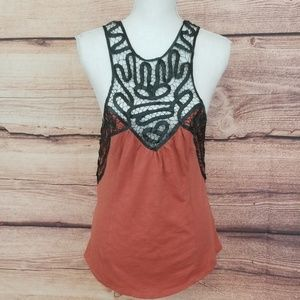 Free People paprika colored top with black det